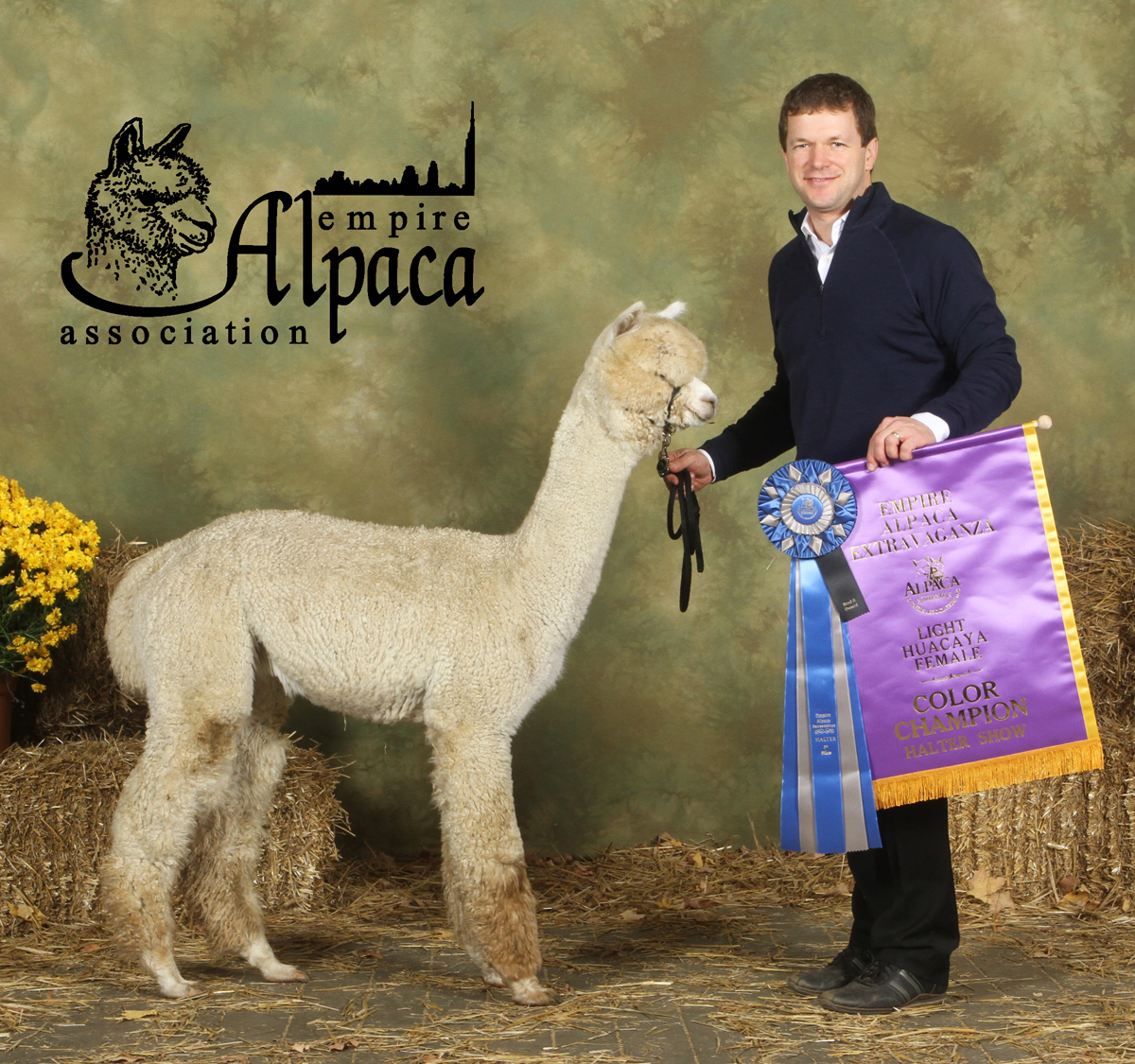 CCNF Caipirinha with one of her 2 Championship banners from the light female color groups at The Showtacular.